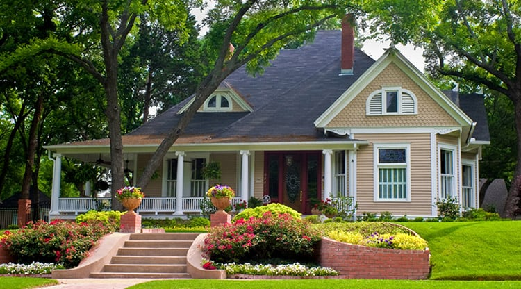 Extremely colorful classic restored house with beautiful landscaping in a rural city.